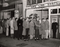 Rev. Avery Heisey stands outside the Life Line Mission in San Francisco, guiding men into the entrance, possibly for a dinner or a preaching service. (Courtesy of the Brethren in Christ Historical Library and Archives)