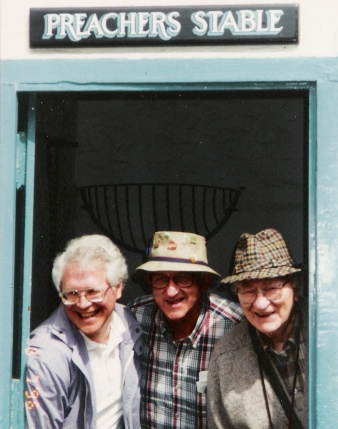 Brethren in Christ educators Luke L. Keefer Jr., Al Long, and Arthur Climenhaga pose for a lighthearted picture while on a tour of England in 1993. (Brethren in Christ Historical Library and Archives)