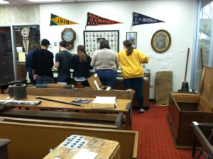 Students exploring archival materials related to the history of Messiah College