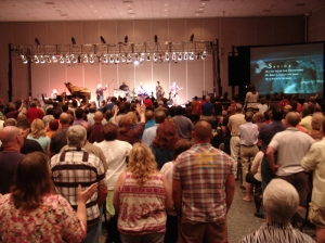 Worship at the Brethren in Christ's 2012 General Conference. Note the worship band and the charismatic expressions such as raised hands (Courtesy of the Brethren in Christ Church U.S.)