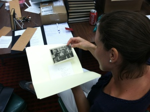 Kristine Frey pages through images from the Brethren in Christ Historical Library and Archives' photo collection