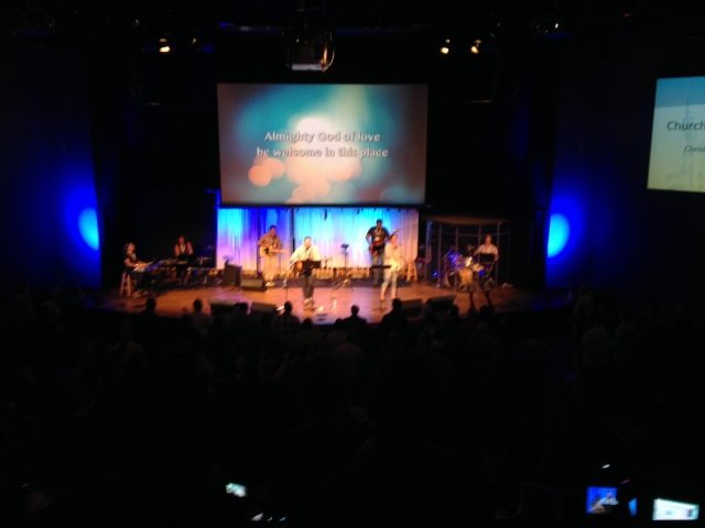 A blurry picture of the megachurch-style worship happening at the Church and Post-Christian Culture conference, a gathering of Anabaptist-minded folks and sponsored by Missio Alliance.