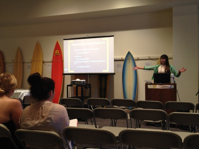 Former Messiah College student Brooke Strayer giving a presentation on the history of the Brethren in Christ peace position at the 2014 Conference on Faith and History undergraduate research conference. Yes, those are surfboards behind her -- she's presenting in the Pepperdine University Surfboard Museum!